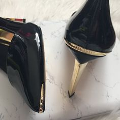 Ted Baker Black Pump w/gold heel The most gorgeous black pump you will own! Has a sexy asymmetrical gold heel and gold detail on the pointy toe. Some barely there store wear on the patent. Black patent. Brand new. Soze euro 41, US 10. Offers welcome through offer tab. No trades. 1422161151 Ted Baker Shoes Heels