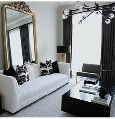 Gold black and white glam condo apartment, featuring a white leather sofa and a vintage gold floor mirror in the back. Loving the solid square black marble coffee table! Home Interior Design, Room Design, Decor, Apartment Decor, Interior, Cozy Living Room Design, White Leather Sofas, Living Room Designs, Room Interior