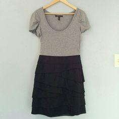 BCBGMaxAzria ruffled dress Short gathered-sleeved dress with gray top and black, ruffled bottom.  Side zipper and snaps.   Great with a blazer for business or a statement necklace for pleasure! BCBGMaxAzria Dresses