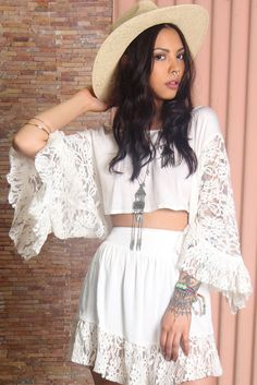 Romantic white top by Somedays Lovin made from smooth woven fabric, in perfect boho-chic style. Features include: scoop neckline, wide, sheer lace sleeves and cropped length