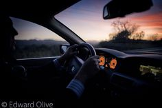 Chauffeur driving BMW wedding car at sunset © Edward Olive photographer