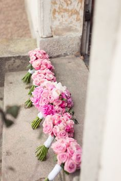 Pink bouquets of peonies and roses, all matching for a spring wedding. #roses #peonies #bridalboquet