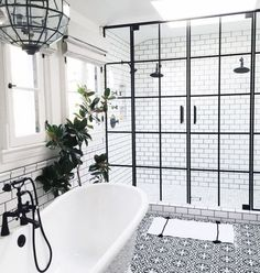 Just Pinned to Salle de bain: Bathroom with black hardware, black framed shower doors, black and white patterned encaustic tile floor, designed by Life Style LA, via Bathroom Renos, Bathroom Interior, Home Interior, Bathroom Ideas, Bathroom Remodeling, Interior Modern, Shower Bathroom, Bathroom Furniture, Bathroom Goals