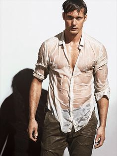 The call of the jungle: Alexander Skarsgard showed just why he was the perfect choice to star as Tarzan on the big screen as he showed off his perfect physique in a soaking wet shirt in a potrait for Vogue