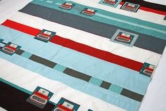 A super cute quilt with melody miller's typewriters. My mother (ex typing teacher) would love this.