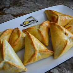 Fatayer are a staple of Lebanese cuisine. The most popular ones you will find daily at local bakeries in Lebanon are sabenekh (Spinach) and lahme (Meat). Lebanese Cuisine, Lebanese Recipes, Greek Diet, Greek Recipes, Arab Food Recipes, Arabic Recipes, Dessert Recipes, Food Items, Recipes