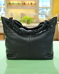 Recycle a leather jacket into a nifty tote bag.  Any trendy fabric will sew into a neat tote also.