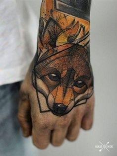 Sketch work fox tattoo on the left hand.