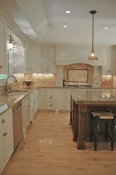 custom cabinets, island, backsplash, wood floor