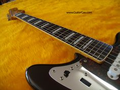 Rosewood fretboard with binding and block inlays on a 2002 made in Japan Fender Jaguar