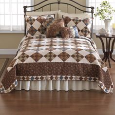The charming, Selina quilt features a patchwork in shades of brown, sage green, and smoky blue, with rose red accents. The solid, white diamonds feature floral medallion quilting.Trimmed with a wide band of chocolate florals and edged in a diamond pieced pattern.