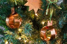 Bring a warm glow to your tree with easy-to-make trimmings crafted from thin sheets of pliable copper. The material is a cinch to shape and cuts with tin snips—witness the 10-point star and strappy orbs we made here. | Photo: John Gruen