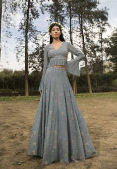 EVA- Ice Blue embellished printed lehenga skirt paired with hand embroidered blouse with ruching details. CARE: Dry Clean Only Indian Gowns Dresses, Indian Fashion Dresses, Indian Designer Outfits, Fashion Clothes, Lehnga Dress, Lehenga Skirt, Jacket Lehenga, Lehenga Choli, Anarkali