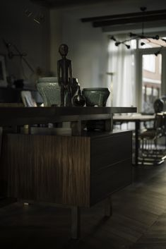 Weesperzijde Amsterdam - Eginstill Kitchen - Green marble countertop, bronze island frame with walnut cabinets .This kitchen was designed in cooperation with Nicemakers