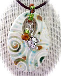 Ocean swirl sea turtle ceramic pendant. www.beachykeenpottery.com