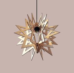 These ornamental star pendant lamps are composed of eight laser-cut wood pattern, easily assembled. They have fallen from the sky to shine on a new space full of magic moments.  All our Invo lighting are entirely made of wood, cut with laser technique. The electric cable is included, except the bulb which remains the choice of the customer.   Luminaire 100% bois. Fabriqué en France. Edition limitée  Dimensions 45 cm x 45 cm 18 inch x 18 inch