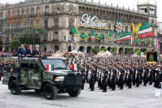 Riding a DN-XI armored vehicle, President Enrique Peña Nieto (center), Secretary of National Defense Gen. Salvador Cienfuegos Zepeda (left), and Navy Secretary Adm. Vidal Francisco Soberón Sanz (right) inspect the troops at the 2014 Mexican Independence Day Parade.