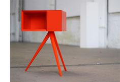 Invisible City's Incunabular Side Table in Red