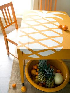 I love this sooooo much! I am so making this!  In a reverse stencil technique, paint the table ivory using flat latex paint. Then cut the pineapple pattern from adhesive shelf paper and stick it on. For graphic pop, place the pineapple off center and let it bleed past the table edges. Paint the table again using an orange hue. When dry, peel off the shelf paper and reveal the pineapple.