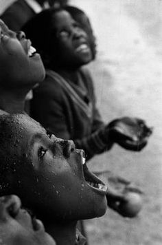 SOUTHERN AFRICA. 1981. Lesotho. School children during a rainstorm. Photo Chris Steele-Perkins