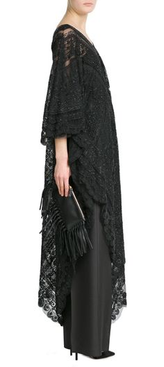 Valentino's black lace kaftan is immediately dramatic, but with a soft feminine edge. The relaxed silhouette lends a bohemian feel, with intricate bead embellishment that adds texture and glamour #Stylebop
