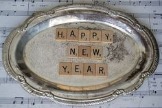Scrabble letters spelling Happy New Year on a silver plate ~ lovely!