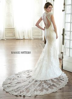 Elegant lace slim A-line wedding dress with plunging illusion neckline and delicate lace sleeves, finished with keyhole back, Melitta by Maggie Sottero.