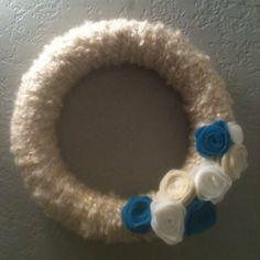Wreath wrapped in yarn with felt flowers!