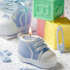 """Fashioncraft Baby Bootie/Sneaker Design Candle, Blue by Fashioncraft. $2.48. Comes packaged in a clear plastic box, tied with a blue satin ribbon, blue striped """"For You'' tag attached; Blue wax candle favor in the stylish shape of a hi-top-sneaker-version of a baby bootie, painted white carved details including laces, toe, sole and more, wick at top, measures 2.75"""" x 1.25"""", exclusively from Fashioncraft's My First Sneaker Collection; Whimsical baby boy themed candle favors, a g..."""