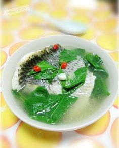 The fresh tilapia and wolfberry leaf soup is a homely dish in Guangdong province. Cantonese Cuisine, Ginger Slice, Fried Fish, Tilapia, Freshwater Fish, Chinese Food, The Fresh, Food Print, Fries