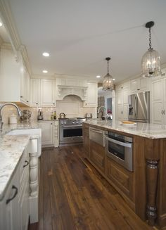 Hi all, The design firm that we bought our cabinets from sent in a professional photographer to take pictures of our kitchen for their ads/portfolio, so I thought I'd post these too since the lighting is significantly better than in the ones I took! Also, giving a link to the original thread with th...
