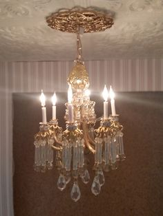 My miniature living room chandelier made from jewelry findings, brass tubing, beads and mini electric candles & LEDS.