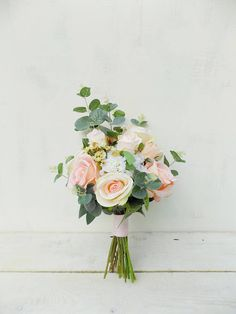 Artificial flowers hand tied bridal bouquet and bridesmaid bouquet. Boho rustic style wedding flowers. Romantic ivory, cream, green and blush peach palette of roses, hydrangea and waxflower. Handle tied with pale pink hessian ribbon. Dimensions: Bridal bouquet approx. 10-11 Bridesmaid