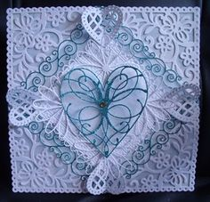 order for 5th anniversary.wanted 5 hearts..hand chalked a patterned vellum to lift the die cuts..And a box to match. by: marilynh