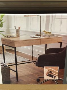Metal and oak desk from Target.  Two power outlets and two sub outlets.  Two storage drawers. $116.99.