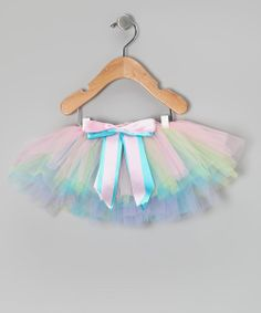With poufs of pretty pastel tulle and a double-layer satin bow, this tutu is a sweetie's divine dream! An elastic waistband keeps it comfy and snug for all her flitting fairy fantasies.