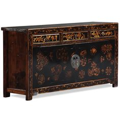 This striking black and gold decorated sideboard is from Shanxi province in central China. The black lacquer finish and paintings are new, but are in keeping with designs seen on furniture from the region and have been beautifully executed. The muted paintings on the doors are in circular patterns, each showing flowers and foliage, whilst the three upper drawers and the outer frame of the cabinet are also decorated in muted gold with flowers.