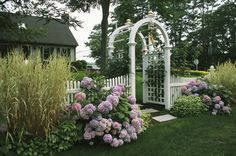 Arbored Entryway with Ornamental Grasses and Blooming Hydrangeas Photographic Print by Darlyne A. Hydrangea Landscaping, Landscaping With Rocks, Front Yard Landscaping, Landscaping Ideas, Backyard Ideas, Garden Ideas, Mulch Landscaping, Small Gardens, Outdoor Gardens