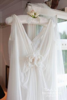 beautiful wedding dress detail photography with flowers by © Radmila Kerl wedding photography munich