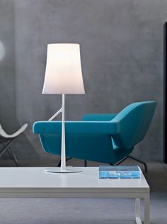 The Foscarini Birdie Table Lamp makes a slick, cheerful addition to modern settings. It features a glistening polycarbonate shade and slim stem with a little branch detail that functions as a touch dimmer. Foscarini, Table, Reading Lamp, Light Table, Table Lamp, Modern, Interior, Interior Styling, Italian Design