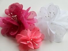 Tutorial on how to make these sheer fabric flowers.