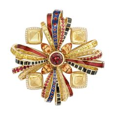 Les Talismans de Chanel Attirante brooch in 18ct yellow gold set with red spinel, pear-cut orange topazes, yellow sapphires and brilliant-cut diamonds.