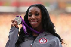 In This Photo: Lashinda Demus  Silver medalist Lashinda Demus of the United States poses on the podium during the medal ceremony for the Women's 400m Hurdles on Day 13 of the London 2012 Olympic Games at Olympic Stadium on August 9, 2012 in London, England.  (August 8, 2012 - Source: Cameron Spencer/Getty Images Europe) - http://www.PaulFDavis.com/success-speaker (info@PaulFDavis.com)