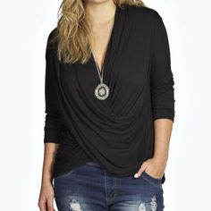 Exquisite Black Cross-Drape Viscose Top Exquisite Black Cross-Drape 3/4 Sleeve Viscose Top This fabric is FABULOUS and gets more wonderful, softer and cozier with every machine wash. Very flattering and hangs fantastic! Tops Blouses