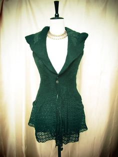 Originally £168 now reduced to £120! This beautiful handmade item is one of a kind and it has been created using Australian merino wool and gorgeous Indian silk organza and antique lace .The silk is in bottle green and it is inlaid into the wool using the nuno felting technique ; the