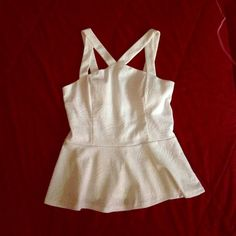 Cute White peplum White peplum with a cross on the chest Charlotte Russe Tops Blouses
