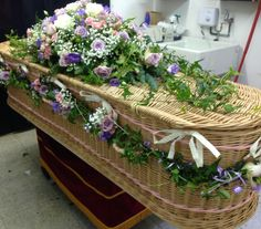 Funeral Flowers. pretty pink and lilac funeral flowers, coffin , casket flowers, coffin garland, rose funeral flowers, flowers for funerals, bespoke funeral flowers,unusual funeral flowers www.thefloralartstudio.co.uk