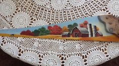 This is a saw blade I painted from a Debbie Towes pattern