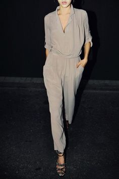 Jumpsuit crafted in polyester, featuring a v neck, notched lapels, zip front closure, long sleeves with turnup cuffs, side pockets to wide thigh, in a loose fit.$73