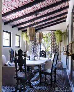 The stenciling on Martyn Lawrence Bullard's dining room ceiling was inspired by a Fortuny fabric.